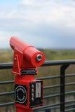 Télescope rouge de visionnement Photo stock