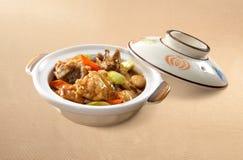 Tête asiatique de poissons de Claypot de nourriture photographie stock libre de droits