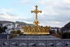 Tête d'or avec la croix Image stock