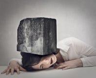 Tête d'une femme flattée par une pierre Photographie stock libre de droits