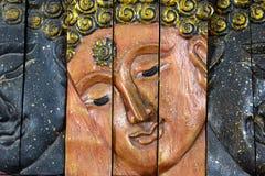 Tête de Bouddha découpée par bois Photographie stock
