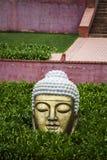 Tête de Bouddha dans le jardin Photographie stock
