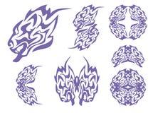 Tête de lion et symboles bleus tribals de lions Photographie stock