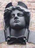 Tête en pierre femelle noire photographie stock