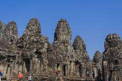 Tête en pierre sur des tours de temple de Bayon à Angkor Thom, Cambodge Images libres de droits