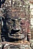 Tête en pierre sur des tours de temple de Bayon Photo libre de droits