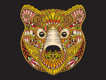Tête fleurie modelée ethnique de broderie d'ours brun Photo stock