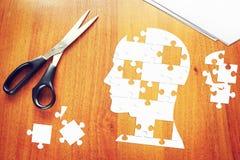 Tête humaine comme ensemble de puzzles Image stock