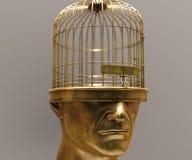 Tête humaine dans la forme de la cage à oiseaux Photos stock