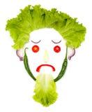 Tête humaine triste faite de légumes Images stock