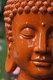 Tête orange de Bouddha Photos libres de droits