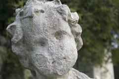 Tête superficielle par les agents de statue Photographie stock
