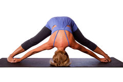 Tête sur la pose d'inversion de yoga de plancher Photographie stock