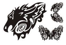 Tête tribale de dragon et symboles tournoyés de dragons Images stock
