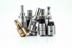 têtes d'E-cigarette d'isolement sur le blanc Photo stock