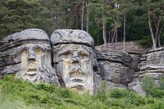 Têtes des diables - sculpture en roche Photographie stock