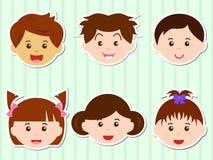 Têtes des filles/des garçons avec le cheveu de Brown Photos stock