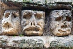 Têtes en pierre effrayantes Photo libre de droits