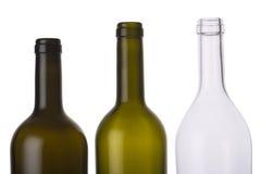 Töm kulöra flaskor Arkivfoto