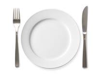 Töm plattan med kniven och dela sig på en vit bakgrund arkivbild