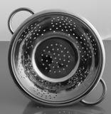 Töm rostfri metall för siktfiltert med handtag Arkivbild