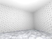 Töm ruminre med den vita tegelstenväggen och betonggolvet Ab Arkivbild
