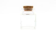 Töm små flaskor med korkproppen som isoleras på den vita backgroen royaltyfria foton