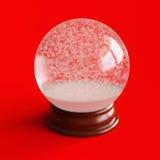 Töm snöjordklotet som isoleras på rött Royaltyfri Bild