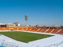 Töm stadionen under snow Arkivbild