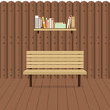 Töm stol på träväggen med bokhyllan Royaltyfri Fotografi