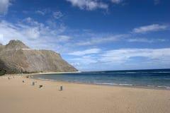 tömmer blåa oklarheter för strand den trevliga skyen arkivbild