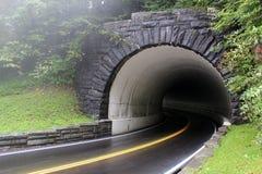 Túnel ahumado de la montaña Foto de archivo
