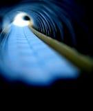 túnel através do caderno espiral Fotografia de Stock
