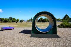 Túnel de madeira colorido do campo de jogos das crianças Levin, Nova Zelândia fotografia de stock royalty free