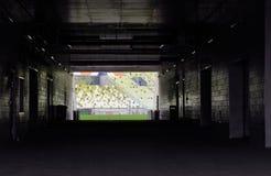 Túnel del estadio que lleva a la echada Imagen de archivo libre de regalías