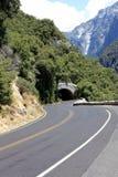 Túnel na estrada de enrolamento Fotos de Stock Royalty Free