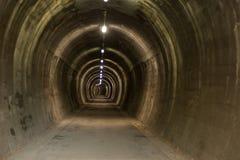 Túnel subterrâneo no ath do ciclo de Alpe Adria fotografia de stock