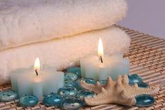 Tücher und Kerzen Stockbild