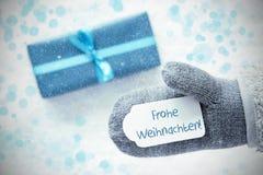Türkis-Geschenk, Handschuh, Frohe Weihnachten bedeutet frohe Weihnachten, Schneeflocken Stockfotos