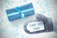 Türkis-Geschenk, Handschuh, Text-Abwehr das Datum, Schneeflocken Lizenzfreies Stockfoto