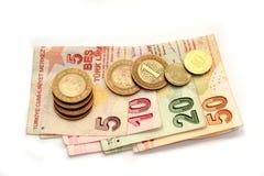Türkische Liramünzen und gefaltete Banknoten stockfoto