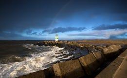 Tęcza nad latarnią morską po burzy Zdjęcie Royalty Free