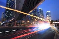 Tęczy Autostrada przy noc z lekkimi śladami Obrazy Royalty Free