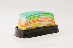 Tęczy crape tort odizolowywający na białym tle Obrazy Royalty Free