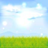 tła błękit chmur trawy zieleni krajobraz opuszczać słońce niektóre słoneczniki tam prawej strony malującemu niebu Zdjęcia Stock