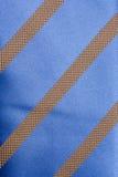 tła błękit paskujący krawat Obrazy Stock