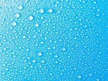 tła błękitny kropel tekstury woda Obrazy Royalty Free