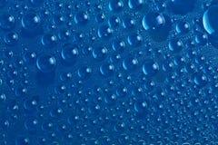 tła błękitny kropel woda Obrazy Royalty Free
