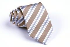 tła beż staczający się krawata biel Zdjęcie Stock