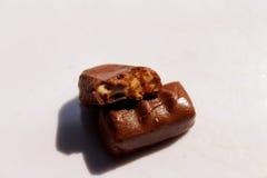 tła cukierku czekoladowego nacięcia odosobniony biel Zdjęcia Royalty Free